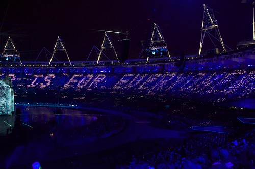 "Photograph Credit: Nick J Webb. ""This is for everyone"" Tim Berners-Lee tweet displayed on LCD screens at the London Summer Olympics Opening Ceremony July 2012. Creative Commons License: CC BY 2.0."