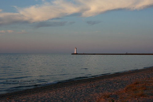 sunset sky lighthouse lake beach water pier newyorkstate lakeontario waynecounty sodusbay soduspoint