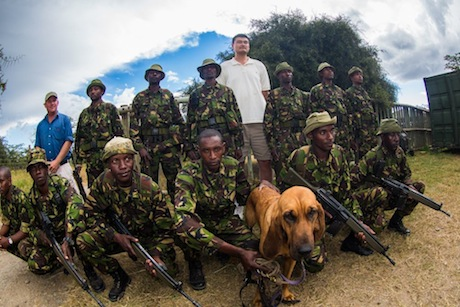 August 2012 - Yao Ming poses with security guards who try to protect rhinos from poaching