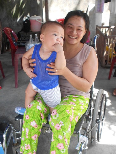Ms. Long Ngru with her child