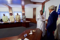 U.S. Secretary of State John Kerry is welcomed to a meeting room at the Presidential Villa in Abuja, Nigeria, on August 23, 2016, before a meeting with Governors of Nigeria's Northern region, and following a bilateral meeting Nigerian President Muhummadu Buhari. [State Department Photo/ Public Domain]