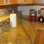 Granite counters and appliances in kitchen
