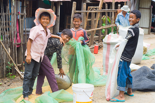 Kids bagging rice