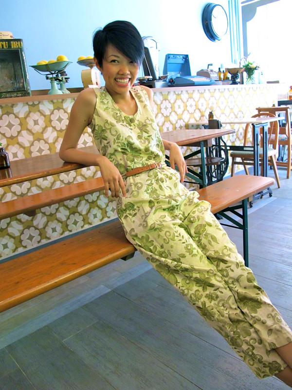 Make them green with envy with this friggin' awesome jumpsuit printed with petals and leaves! Worn here cinched with a skinny belt.