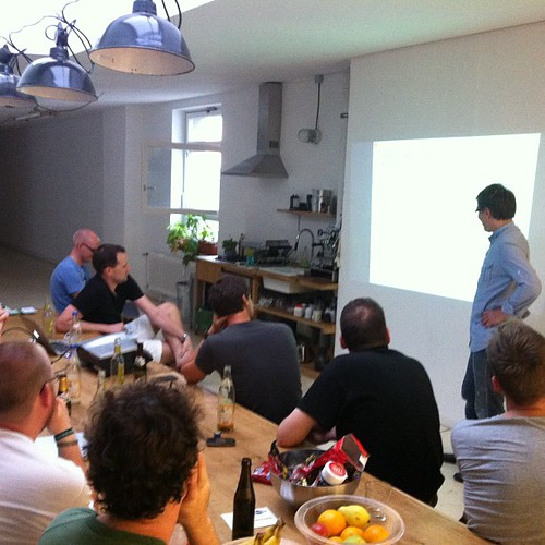 Django meetup. Dude gets his balls busted for the tiny font and low contrast.