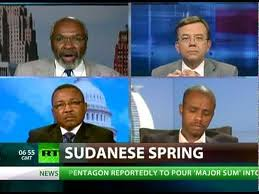 Abayomi Azikiwe, editor of the Pan-African News Wire, upper left, on RT satellite television's CrossTalk program on July 5, 2012. The program featured a debate on Sudan. by Pan-African News Wire File Photos