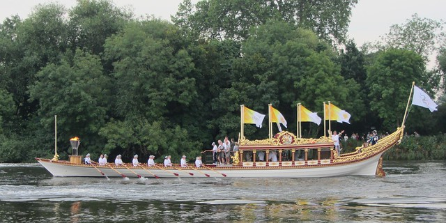 The Olympic flame on board Gloriana
