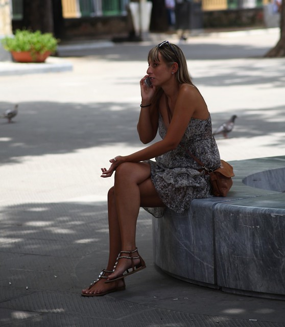 On the streets of Carrara: Girl with a phone
