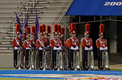 sports(0.0), podium(0.0), bandy(0.0), marching band(1.0), musician(1.0), musical ensemble(1.0), marching(1.0), team(1.0),