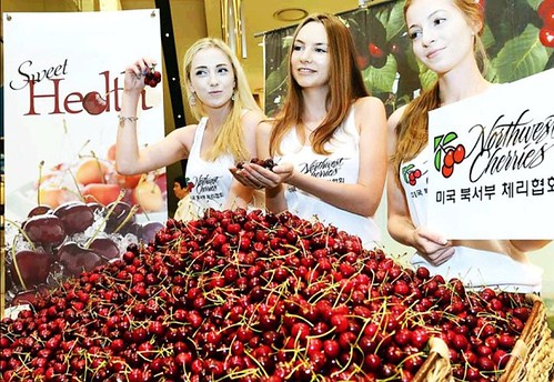 "USDA resident cooperator, Northwest Cherry Growers, promote fresh U.S. cherries at a Korean discount chain store for ""Cherry Day"" on July 2. The elimination of a 24-percent import duty on cherries – along with marketing support from the U.S. cherry industry and the Foreign Agricultural Services in Seoul – is helping boost U.S. cherry sales in Korea to record levels. The implementation of the historic U.S.-Korea free trade agreement (KORUS) in March removed two thirds of the tariffs imposed on U.S. food and agricultural products exported to South Korea. Photo credit Northwest Cherry Growers, Seoul, Korea."