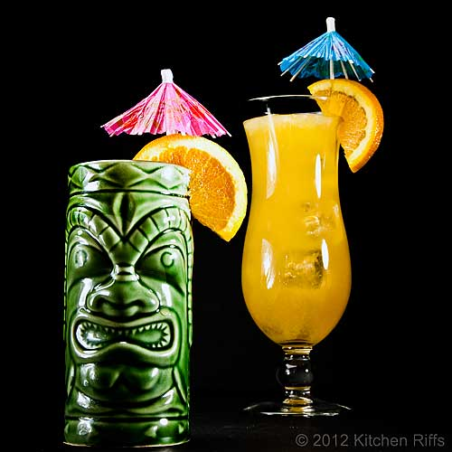 Fog Cutter Cocktails in Tiki Mug and Glass, Orange Garnish and Umbrella