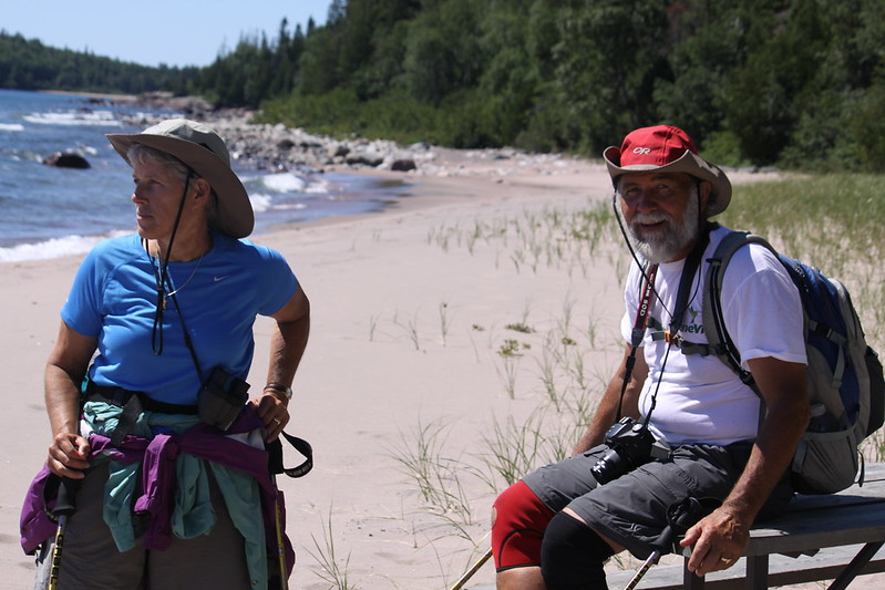 Mike Link and Kate Crowley stopping for a rest on their hike around Lake Superior