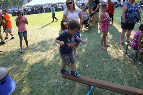 Olsen walks on the balance beam