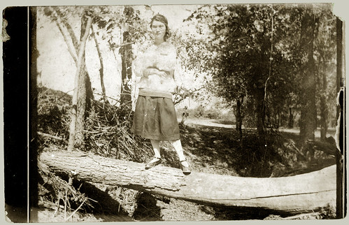 Girl on a log