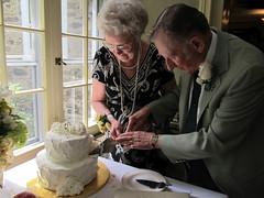 Grandma and Grandpa Cut the Golden Anniversary Cake