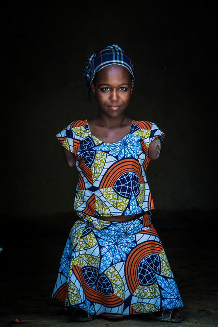 """Aicha, Lawyer, Niger.<br /> <br /> """"I come from Damassak in Nigeria. I would like to become a lawyer so I can defend people's rights. I was born with a disability, but I tend to forget about my handicap because I want to achieve my goal in life. I have been a refugee in Niger for 8 months now. I am happy here.""""<br /> <br /> Photo by Vincent Tremeau, 2016"""