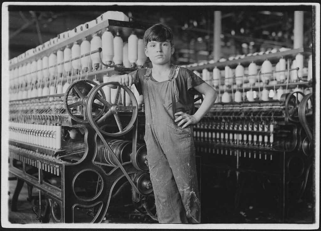 At machine is Stanislaus Beauvais, has worked in spinning room for two years, October 1911