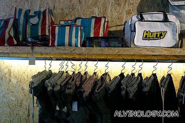 "I love the ""refugee bag"" design on the top shelf"