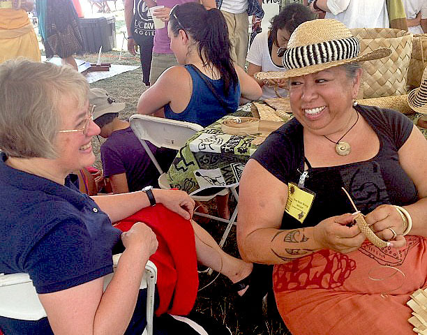 <p>Hawaii Community College Instructor Noe Noe Wong-Wilson teaches lauhala weaving at the University of Hawaii exhibit at the Smithsonian Folklife Festival.</p>