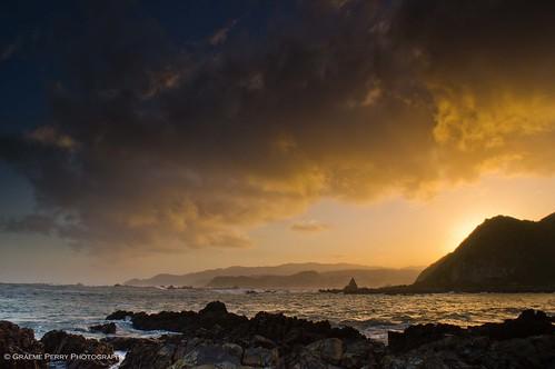ocean new sunset sea newzealand beach water coast rocks sony wave zealand shore nz coastline alpha southcoast aotearoa sonyalpha