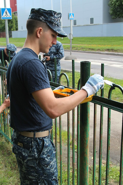 USS Farragut Sailors Paint a Fence at Tallinn Tondi School, August 9, 2012