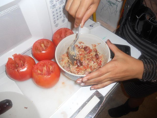 Teen preparing stuffed tomatoes