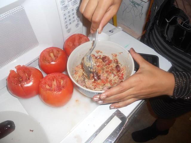 Teen preparing stuffed tomatoes