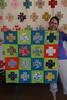 Modern crosses baby quilt by hollybroadland