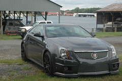 executive car(0.0), cadillac cts-v(0.0), automobile(1.0), automotive exterior(1.0), cadillac sts-v(1.0), cadillac(1.0), wheel(1.0), vehicle(1.0), rim(1.0), full-size car(1.0), mid-size car(1.0), cadillac sts(1.0), cadillac cts(1.0), bumper(1.0), sedan(1.0), land vehicle(1.0), luxury vehicle(1.0),