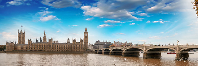 Westminster, London. View of Bridge and Houses of Parliament from across river Thames