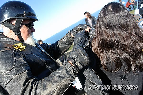 Helping us put on leather jackets for the Harley biker look