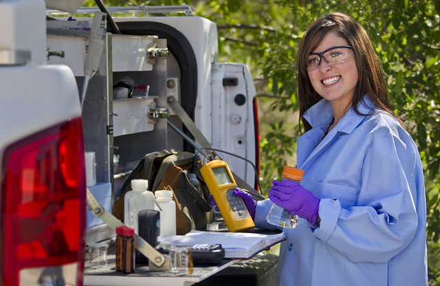 Los Alamos National Laboratory undergraduate student, Erica Garcia, samples levels of chlorine and pH level in water around the Laboratory.