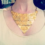 gold swirl breastplate necklace