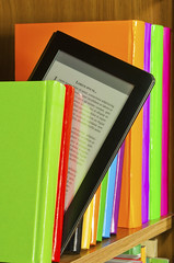 e-reader on bookshelf