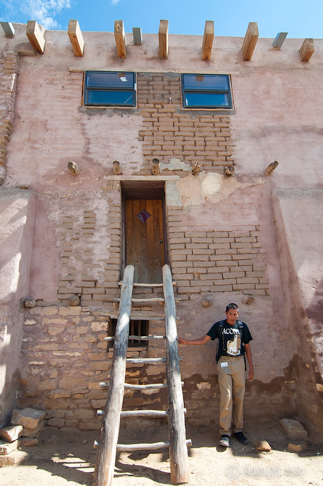Acoma Pueblo building and our tour guide