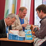 Frank Cottrell Boyce and Andrew Motion signing | Frank Cottrell Boyce and Andrew Motion sign books for eager readers