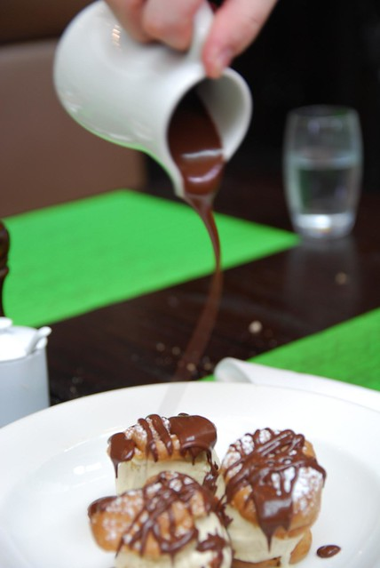 Pouring chocolate sauce Profiteroles, vanilla bean ice-cream AUD16 ...