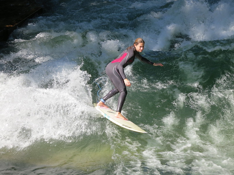 Surfing a tributary of the Isar in Munich