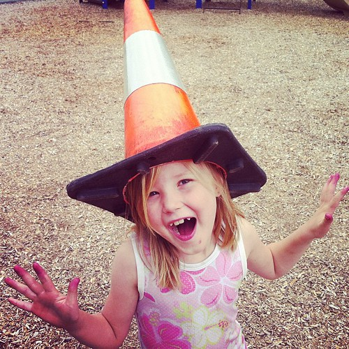 Kid and caution cone