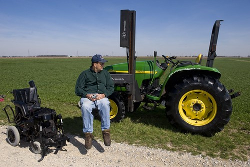 NIFA's AgrAbilty Project recipient uses modified lift to transfer from wheelchair to tractor.  Photo credit:  National AgrAbility Project at Purdue University.