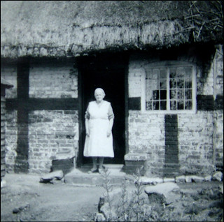 My great great aunt Sarah Turner at the door of her Shropshire Frame Cottage in Arleston