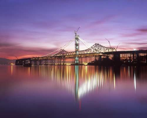 new old morning bridge light sky sun color reflection tower 120 film water clouds sunrise island dawn lights oakland mirror bay construction san francisco treasure demolition calm led east velvia 6x7 sas yerba eastern provia span buena rz67 e100 rz68
