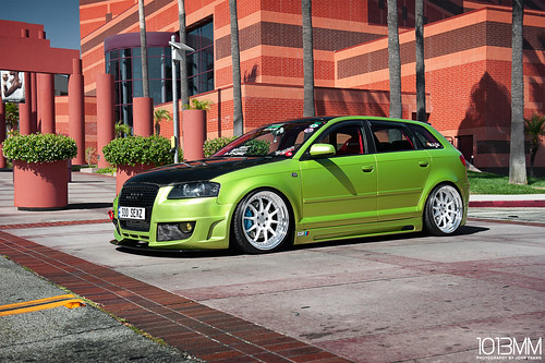 green audi a3 with white ssr wheel rim black hood