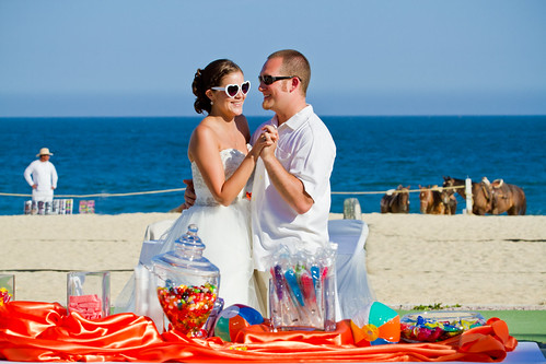 beach wedding first dance in front of candy bar