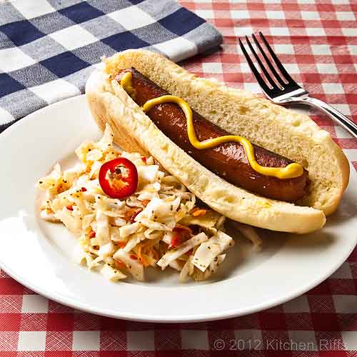 Garlic Coleslaw with Red Jalapeño Pepper Garnish on Plate with Hot Dog