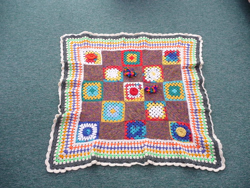 I hope Salma likes this one. Her squares are included. A combination of Knitted and Crocheted, perfect border! Thank you!