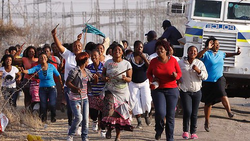 South African women protest in the aftermath of the killing of over 30 miners by the police on August 16, 2012. President Zuma has expressed shock and dismay. by Pan-African News Wire File Photos