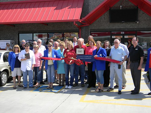 Acting Deputy Under Secretary Judith Canales (sixth from right) participates in a ribbon cutting ceremony for flex-fuel pumps in Waynesville, Missouri, funded in part through USDA's Rural Energy for America Program.