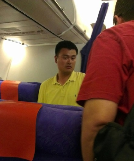 August 23rd, 2012 - Yao Ming sits in a coach seat from Hong Kong to Sichuan