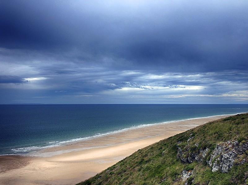 Dark Sky Over A Blue Sea
